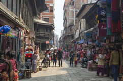 Ason Tole Market is busy with workers, local and tourists in front of the Ganesh Shrine, Indra Chowk, Kathmandu Nepal. Royalty Free Stock Photo