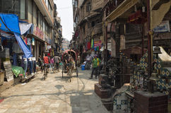 Ason Tole Market is busy with workers, local and tourists in front of the Ganesh Shrine, Indra Chowk, Kathmandu Nepal. Royalty Free Stock Photography