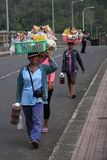 Asongan. 3 ladies trying to sell foods and drink at bakung bridge bali indonesia Stock Images