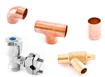 Asorted Plumbing Fittings. Assorted Plumbing Fittings isolated on a smooth white back ground including a 15mm copper elbow T and socket, a self tapping tap and a Royalty Free Stock Images