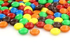 asortowanego tła kolorowi cukierki biały Zdjęcie Stock