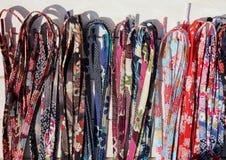 Asortyment shoelaces robić z Chirimen płótnem, japońska tradycyjna kimonowa tkanina zdjęcia royalty free
