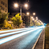 Aspalt road with illuminations in the city Stock Image