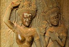 Aspara Dancer sexy boobs girl stone carving ancient bas. Angkor Wat in Siem Reap Cambodia royalty free stock photo