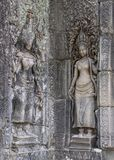 Aspara ladies carved in the temple walls. The statues have weathered over time but remain beautiful and incredibly detailed stock images