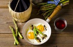 Asparagi with fried egg Stock Image