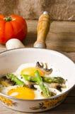 Asparagi with fried egg Stock Photos