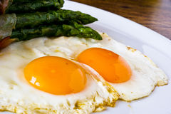 Asparagi with fried egg brown Stock Image