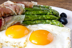 Asparagi with fried egg brown Stock Photo