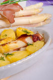 Asparagi and ham brown Royalty Free Stock Image