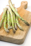 Asparagus. Handful raw green asparagus on cutting board Royalty Free Stock Images
