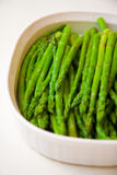 Asparagus. Plate of cooked asparagus on a whte background Stock Images