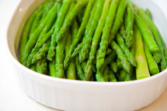 Asparagus. Plate of cooked asparagus on a whte background Royalty Free Stock Image