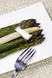 Asparagus. Fresh steamed asparagus both green and white on a plate Stock Photography