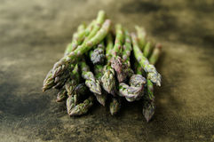 Asparagus. A still life of asparagus on a textured background royalty free stock photo