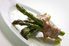 Asparagus. With bacon strips around Royalty Free Stock Image