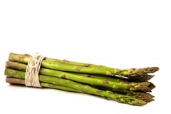 Asparagus. Bunch tied with string laying flat on white background Stock Photography