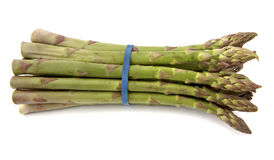 Asparagus. Bunch of asparagus tied with blue ribbon Royalty Free Stock Photography