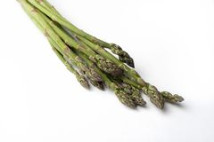 Asparagus. A bunch of green asparagus on a white background Royalty Free Stock Image