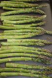 Asparagus. Fresh asparagus on a baking sheet for roasting Stock Image