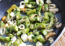 Asparagus. Pan of sea food and asparagus Stock Images