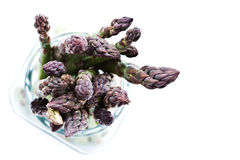 Asparagus. Fresh asparagus in a glass jar on white Royalty Free Stock Images