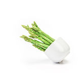 Asparagus arrange in a white cup  on white background Stock Image