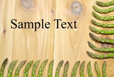 Asparagus. Arranged as a frame on the wooden table Royalty Free Stock Photo