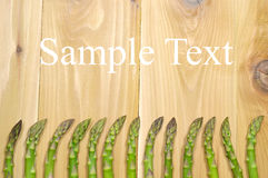 Asparagus. Arranged as a frame on the wooden table Royalty Free Stock Photos