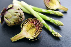 Asparagus with artichoke Stock Images