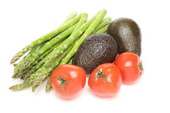 Asparagus,avocados and tomatoes in a white background Stock Photos