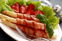 Asparagus and bacon. Royalty Free Stock Images