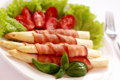 Asparagus and bacon. Royalty Free Stock Image