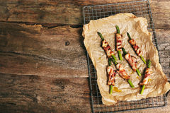 Asparagus with bacon Stock Images