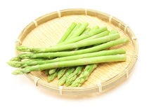 Asparagus on a bamboo colander Royalty Free Stock Image