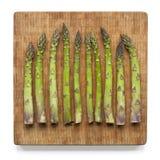 Asparagus on bamboo cutting board Stock Photos