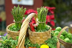 Asparagus Basket. A garden basket includes decorative asparagus bunches Royalty Free Stock Photography