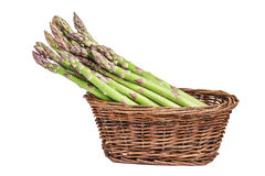 Asparagus in basket isolated on a white. Background Stock Photos