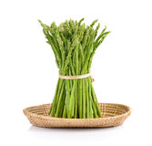 Asparagus in the basket on white background. Asparagus in the basket on a white background Stock Photos