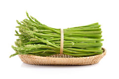 Asparagus in the basket on white background. Asparagus in the basket on a white background Stock Image