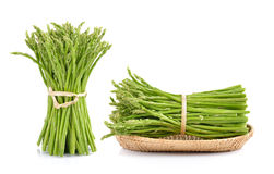 Asparagus in the basket on white. Background Royalty Free Stock Photos