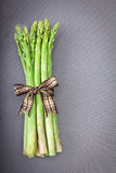 Asparagus bind with brown ribbon on blue grey background Stock Photos