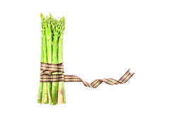 Asparagus bind with brown ribbon on white background and text sp Stock Photography