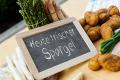 Asparagus with blackboard and german words Royalty Free Stock Images