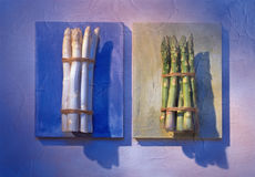 Asparagus on blue boards Royalty Free Stock Photography