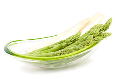 Asparagus in bowl Stock Images