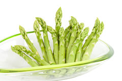 Asparagus in bowl on white background Royalty Free Stock Image