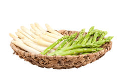 Asparagus in bowl on white background Stock Photos