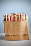 Asparagus in a brown paper bag Stock Photography