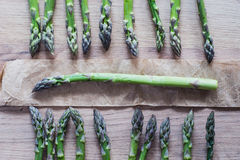 Asparagus bunch close up on wooden background Royalty Free Stock Photos